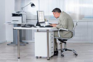 hunchback posture at the desk